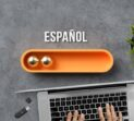 stylized loading bar with the word SPANISH in Spanish and office equipment on concrete background